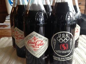 (10) 1984 Olympic Commemorative 10 OZ. Coca Cola bottles / unopened